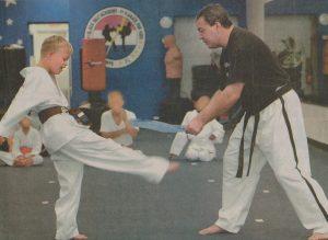 Sam kicking karate