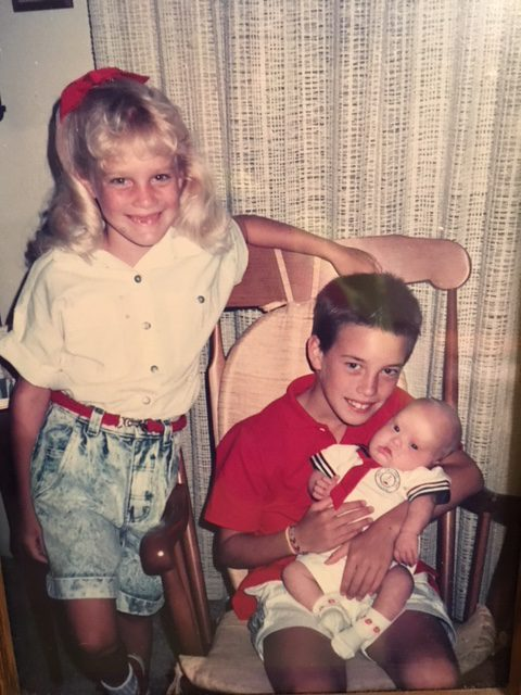 Sam as baby with siblings