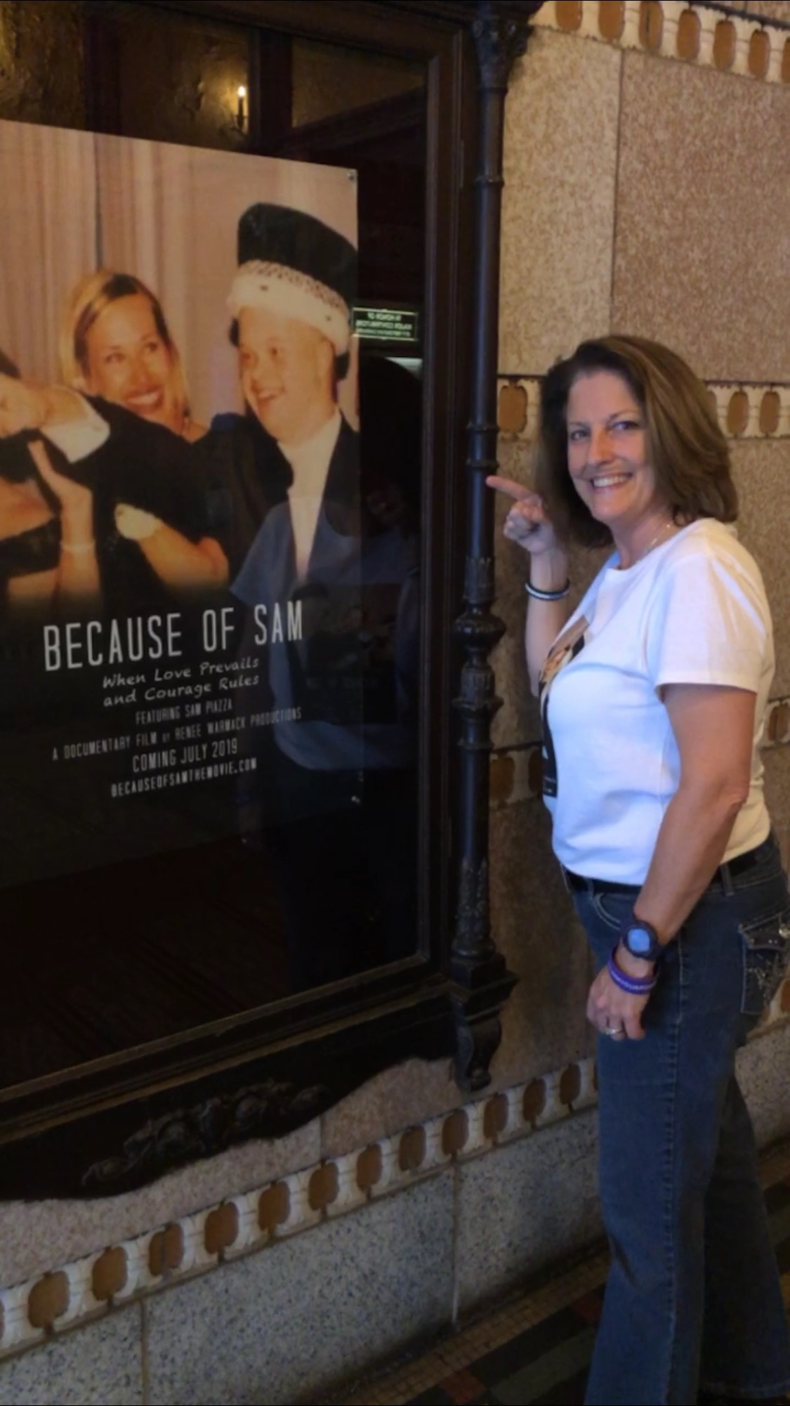 Renee Warmack in front of Tampa Theatre large Movie poster