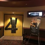 AMC The Regency 20 Theatres Community Screening of Because of Sam - Renee Warmack and Sam Piazza in front of sign-entrance to movie theatre