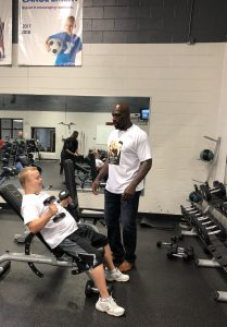 Sam Piazza and WWE Superstar Titus O'Neil