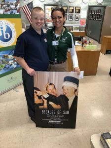 Sam Piazza and Heather Holloway - Walker Middle Magnet School Principal holding Because of Sam Movie Poster