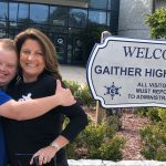 Sam Piazza and Renee Warmack in front of Gaither High School sign