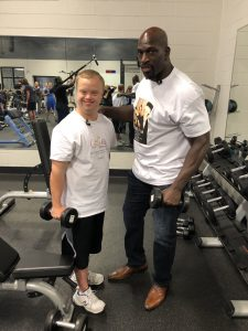 Sam Piazza and WWE Superstar Titus O'Neil at YMCA